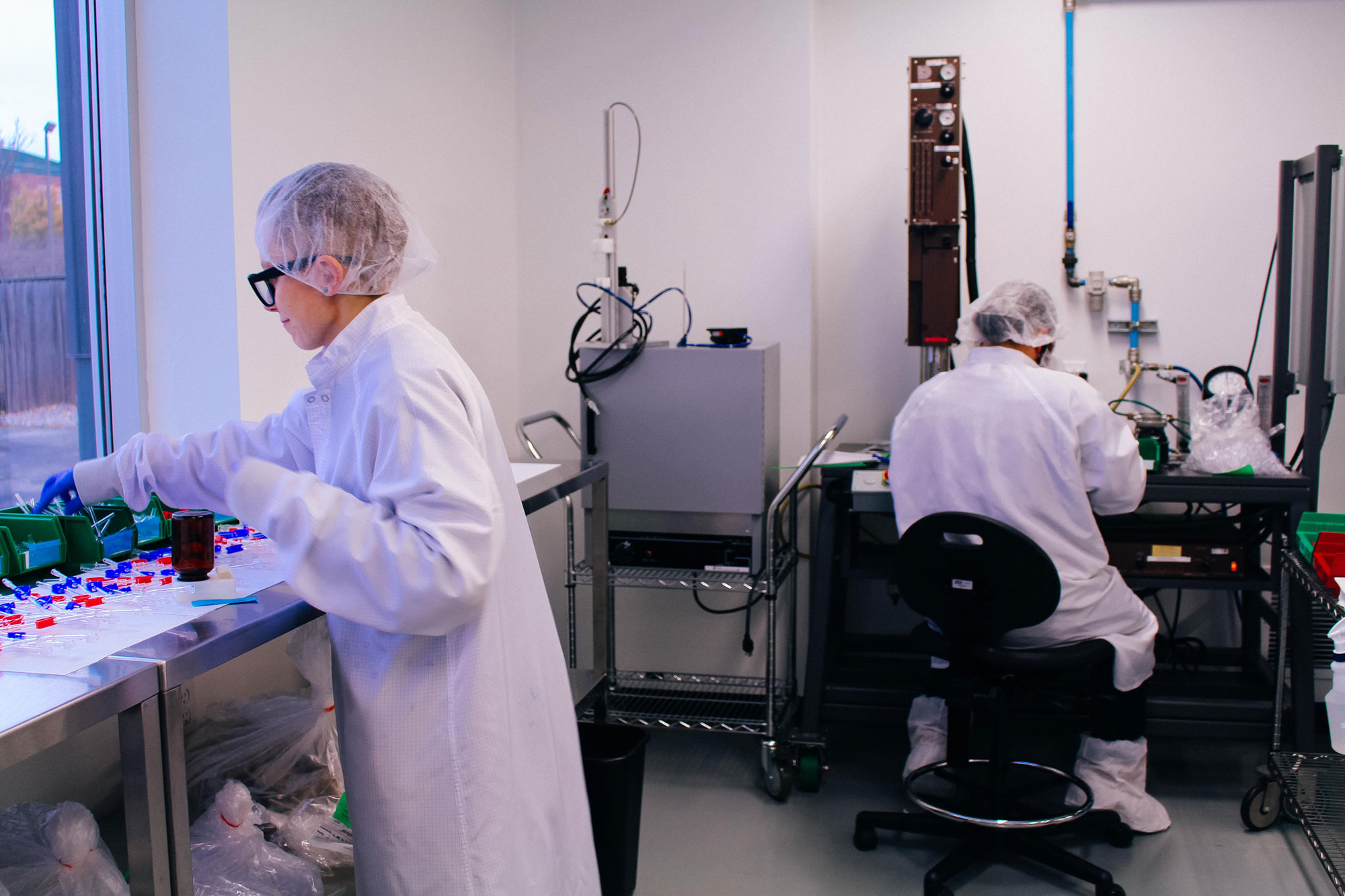 An image of lab workers closing out their day in the iso class 7 cleanroom.